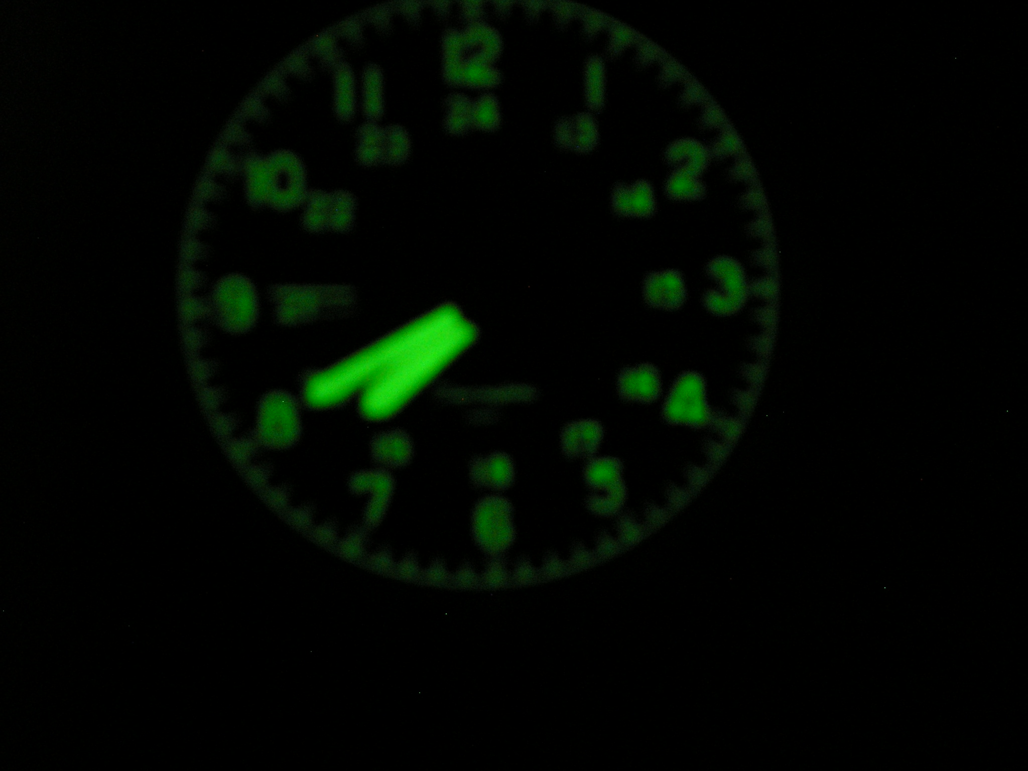 Military clock face after UV light exitation